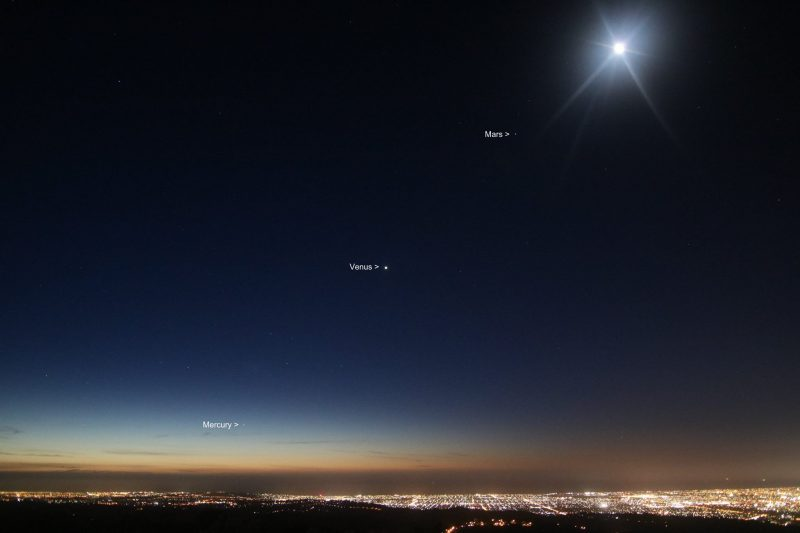 If you're in the Southern Hemisphere, expect to see the 3 planets shown on our chart at top - Mercury Venus and Mars - angled up from left to right above he sunset. Photo taken December 5, 2016 by PK Imaging in New Zealand. The bright object at the top is the moon.