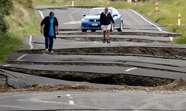 Residents look at damage caused by an earthquake, along State Highway One near the town of Ward, New Zealand. Image  Anthony Phelps/Reuters via The Guardian
