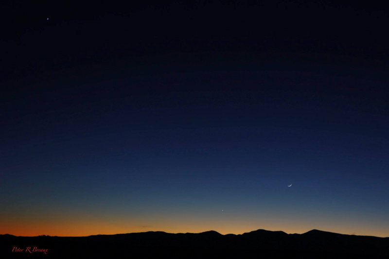 View larger. Congratulations to Peter Rodney Breaux of New Mexico who caught the slender waxing crescent moon, plus the planets Mercury and Venus after sunset November 30, 2016! Mercury shines to the lower left of the moon while Venus beams at the top left.