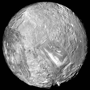 Image of Miranda, largest moon of Uranus, showing sharp haphazard surface features.