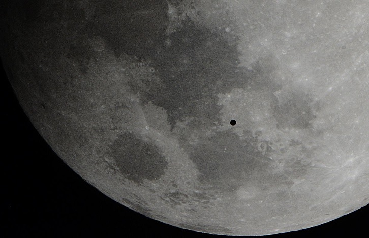 Round object crosses the moon