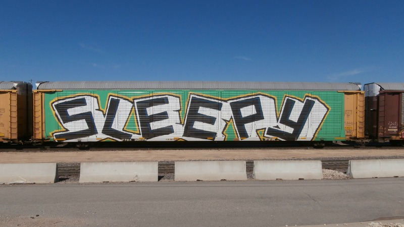 The word Sleepy painted on the side of a train car.
