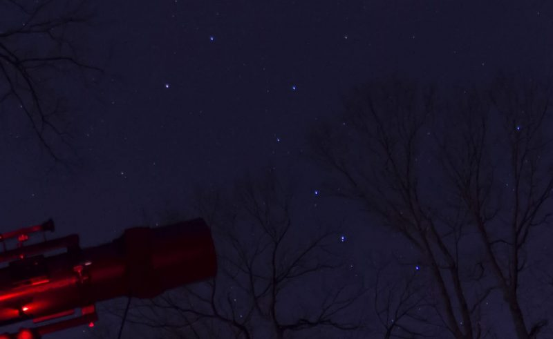 The Big Dipper with one of the stars accompanied by a faint second star.