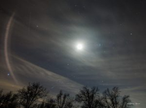 Bright moon surrounded by Winter Circle stars.