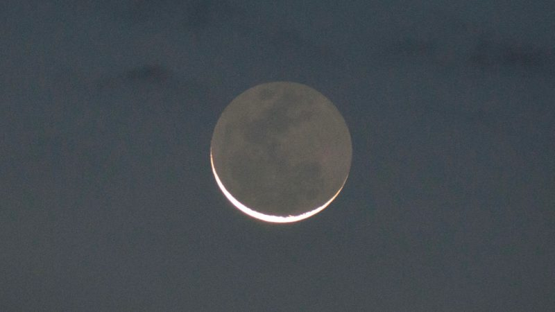 Earthshine on old moon.