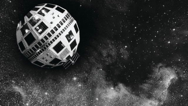 Faceted spherical satellite with dark rectangles, against starry sky.