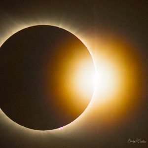 A totally eclipsed sun with a bright light emerging on one side: the diamond ring effect.