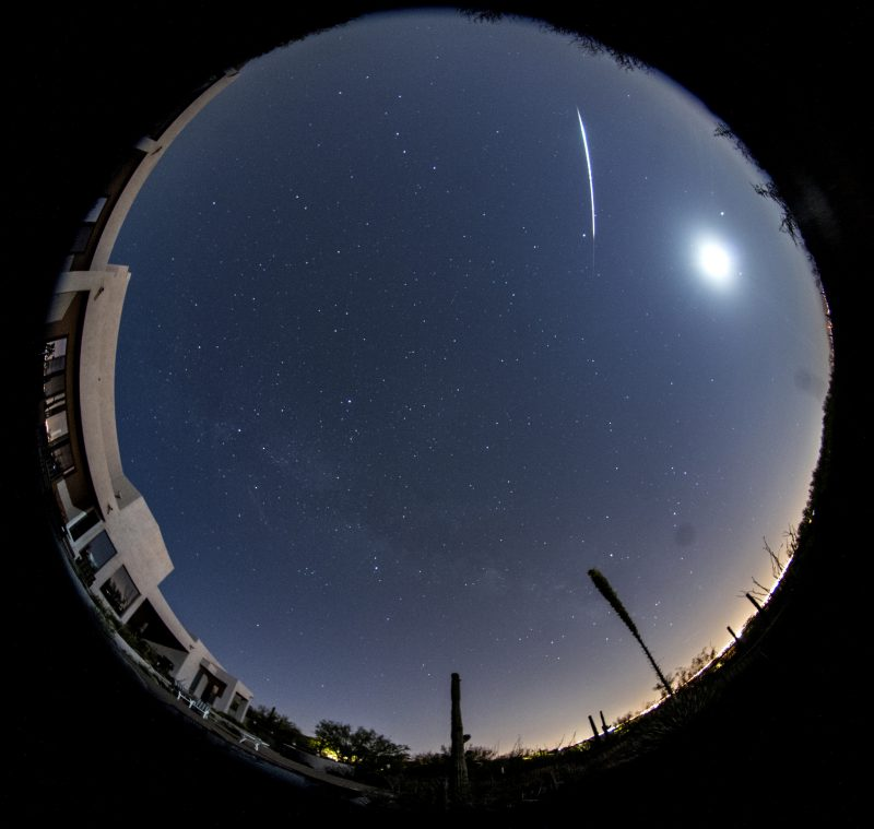 Circular panorama with bright moon and very bright meteor streak.