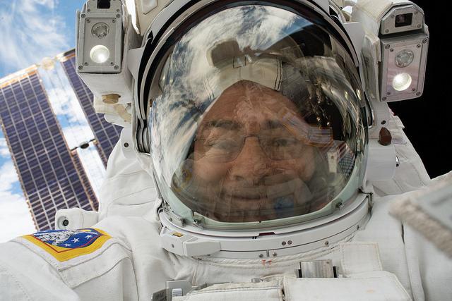 NASA astronaut Mark Vande Hei captured this selfie with his helmet visor up during a spacewalk