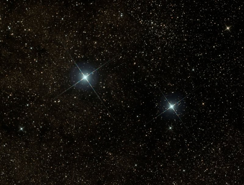 Star field with two bright, prominent stars.