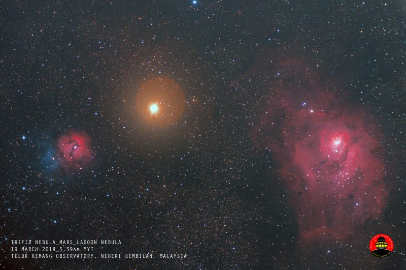 Orange orb at center, red and blue nebula on left, large red blob at right.
