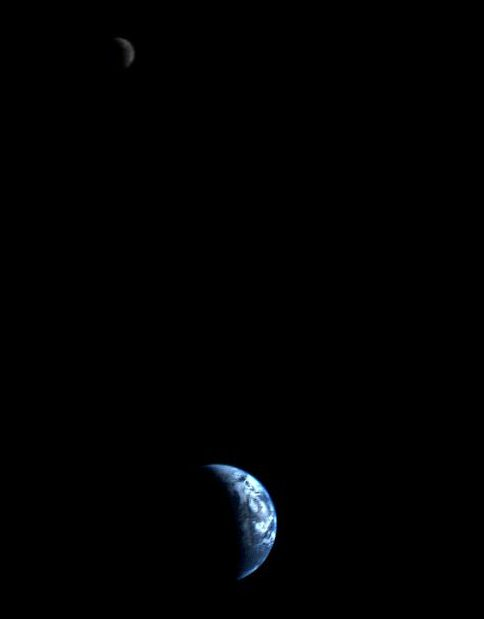 Small blue and white Earth and distant moon, both same crescent phase.
