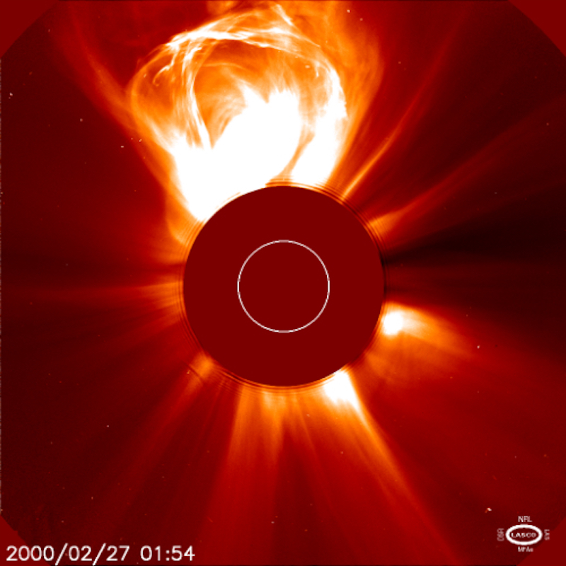 The sun, the center blocked for visibility, with a great white extrusion coming out from near the top.