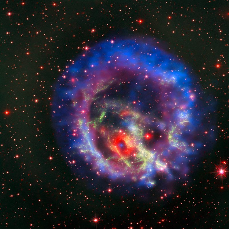 A colorful expanding shell around an internal region that appears chaotic.