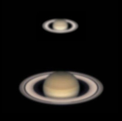 Small fuzzier photo of Saturn with rings above larger less fuzzy photo.