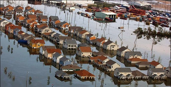 Aerial view of rows of beach houses, flooded.