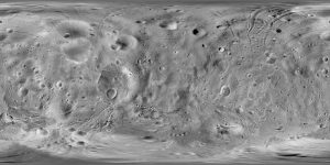 Gray terrain covered by craters and grooves.