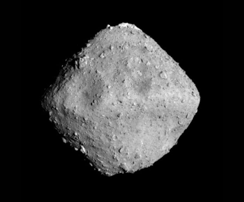 Rocky asteroid Ryugu, diamond-shaped, like a spinning top.