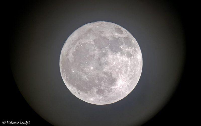 Detailed white full moon closeup.