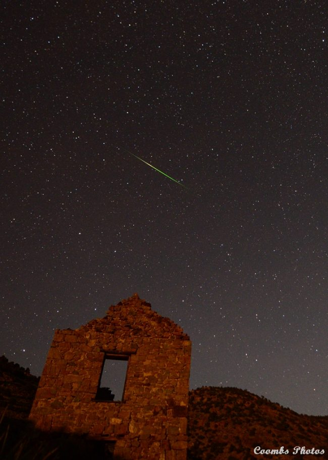 Leonid meteor above ruined building