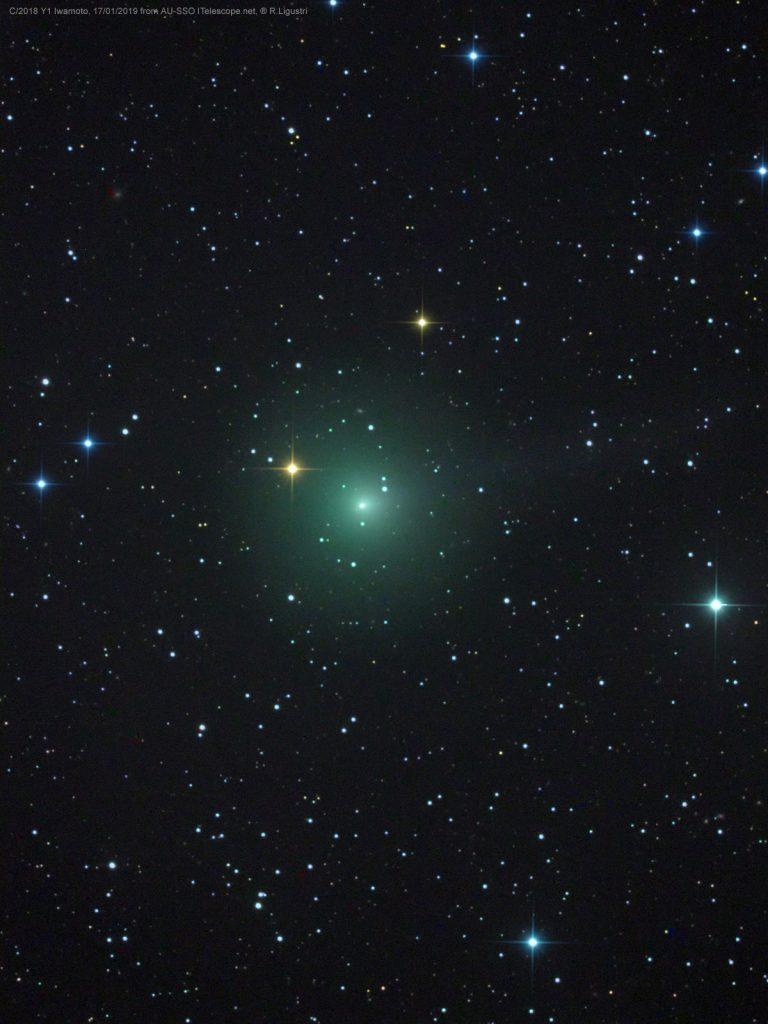 Star field with big fuzzy green spot.