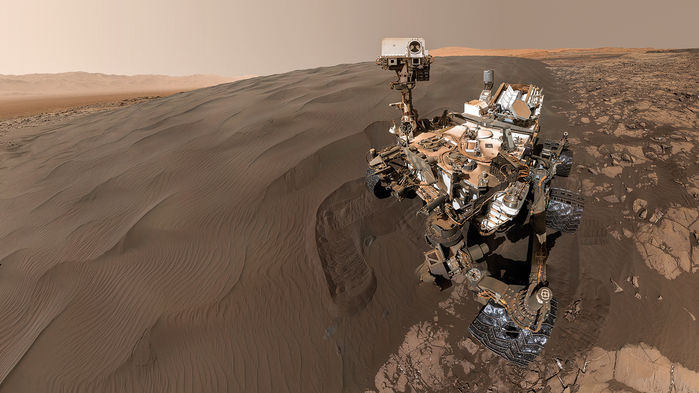 Curiosity rover on sandy hillside