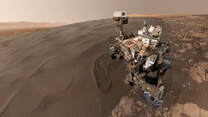 Curiosity rover on sandy hillside