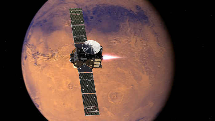 spacecraft with solar panel wings and rocket exhaust in orbit above Mars