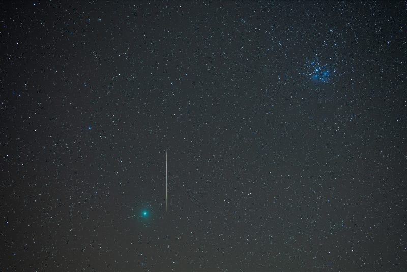 meteor streaking beside green Wirtanen