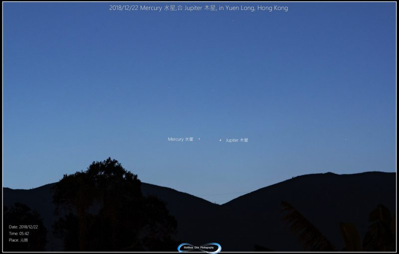 faint Jupiter and Mercury above dark hills