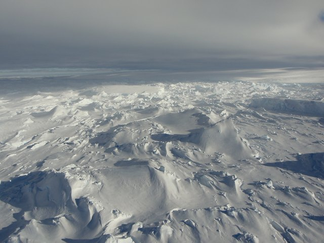Aerial photo of Totten glacier in East Antarctica, ice and snow to the horizon