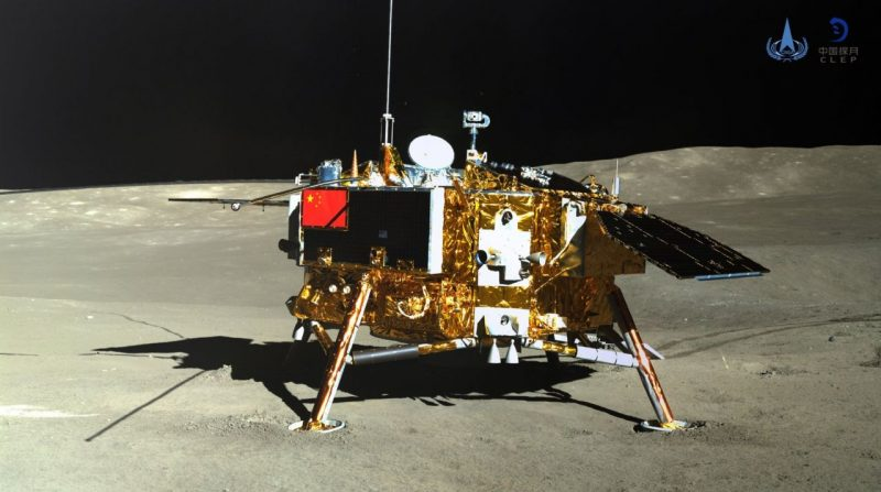 Gold-colored four-legged lander, covered with instruments, on lunar landscape.