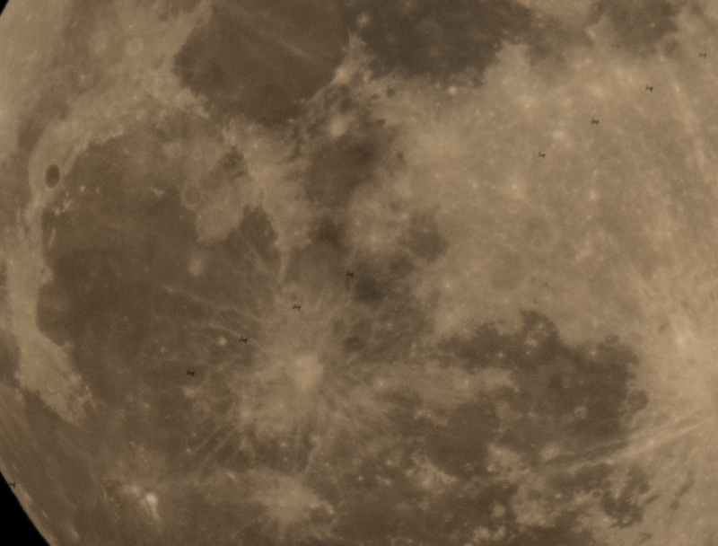 Close-up of moon's surface, with dotted line of silhouettes of ISS passing in front.