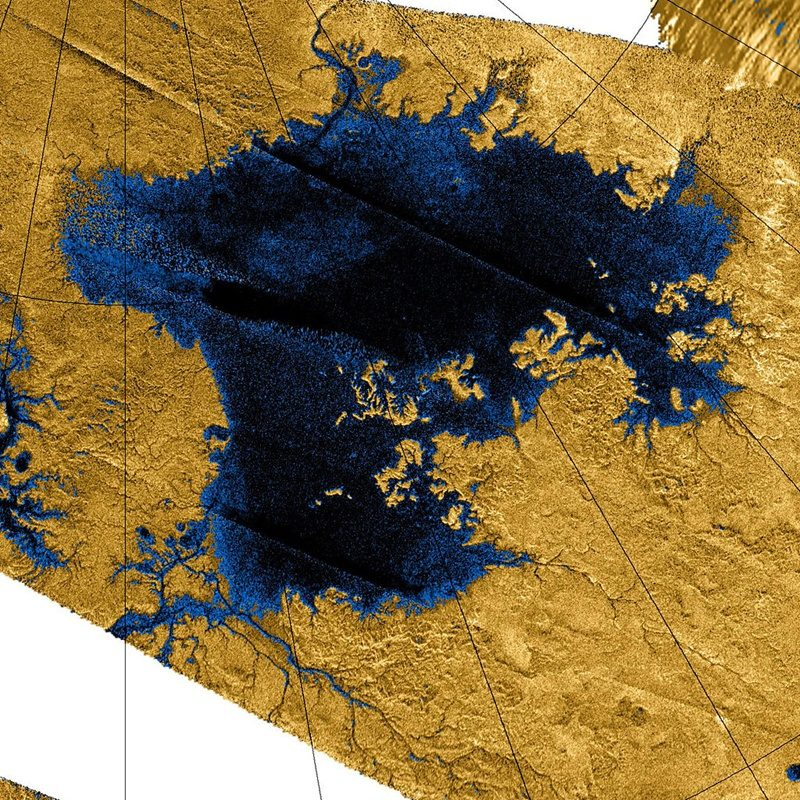 Deep blue irregular patch with tributary streams running into it.