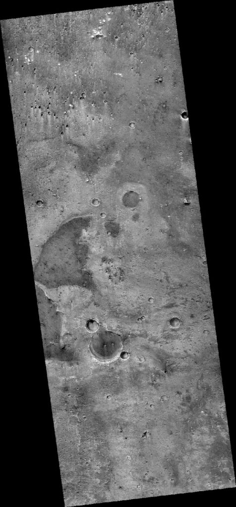 A portion of Oxia Planum - the landing site of the ExoMars rover in 2020. Mostly smooth landscape with a few craters.