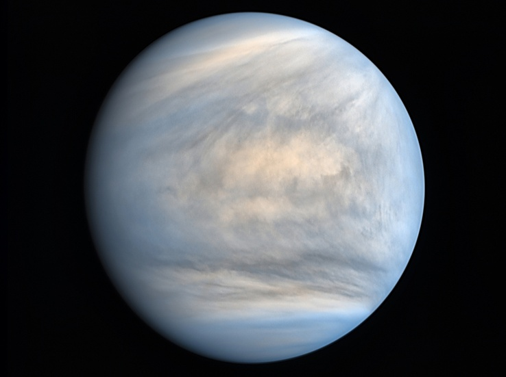 Pale blue planet with streaks close to the poles.