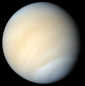 In regular visible light, Venus' clouds are a lot blander appearing, as seen in this image from Mariner 10 in 1974.