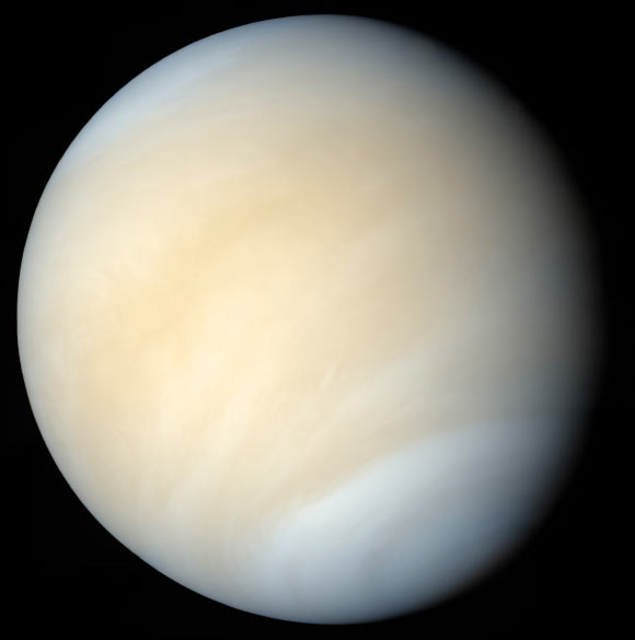 Pale yellow cloud-covered planet.