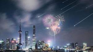 Fireworks over Shanghai, China, with artificial meteors in the sky.