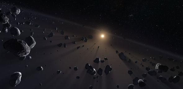 A dim distant sun and small rocky bodies moving around it.