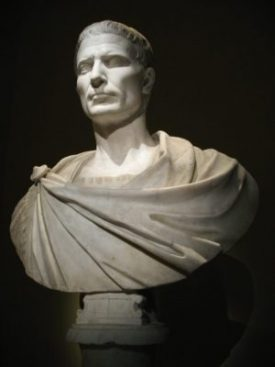 White marble bust of Julius Caesar, a short-haired Roman with a toga wrapped around his shoulders.