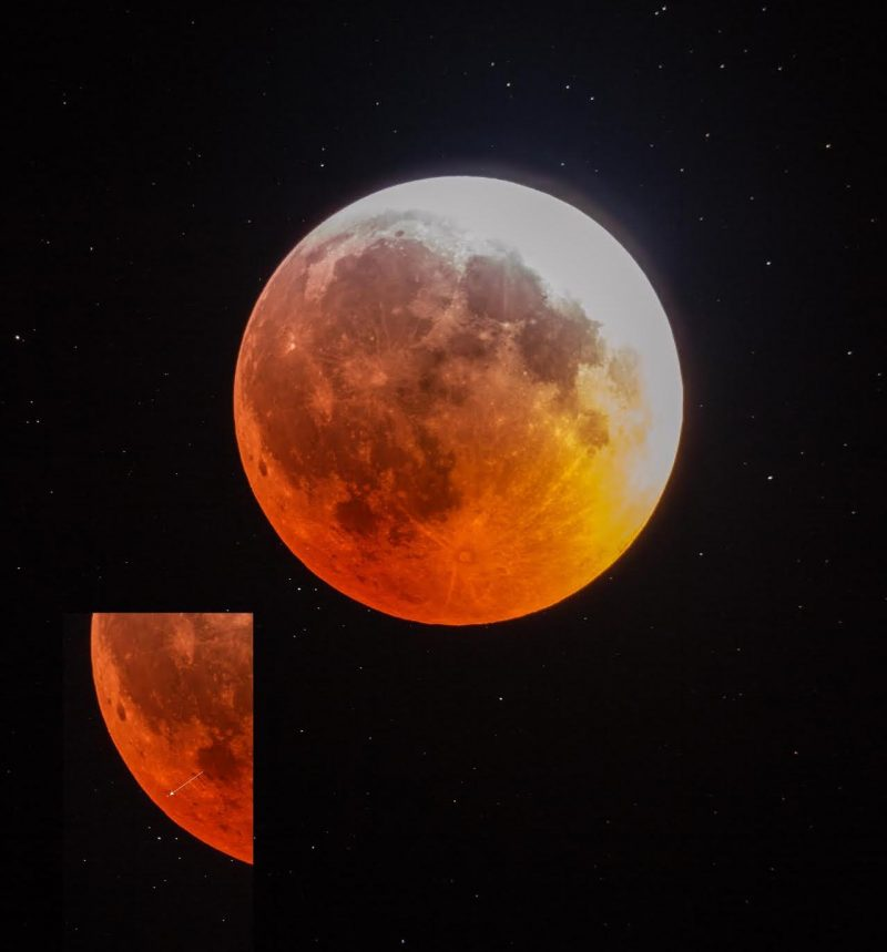 Whole disk of red, eclipsed moon with inset showing meteorite strike at about 7 o'clock.
