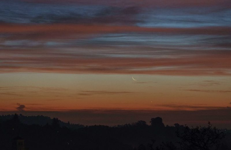 Crescent moon and tiny Mercury at sunrise.