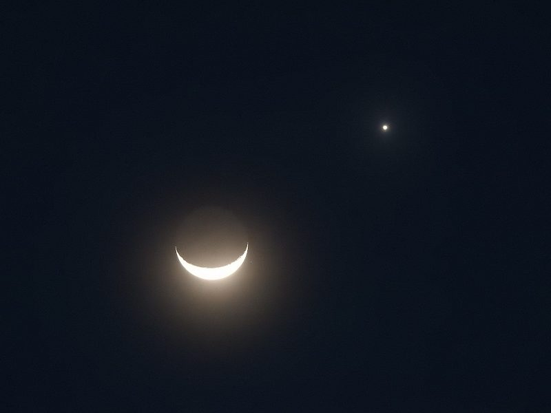 Photo of the crescent moon and planet Venus in the dark sky before sunrise on January 2, 2019 over Singapore.
