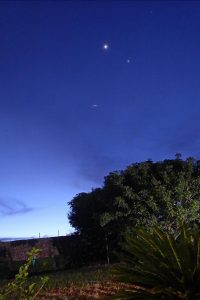 Bright dots of planets and stars, plus a short streak, the satellite.