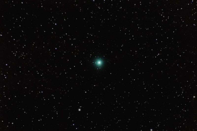 Medium-sized fuzzy green dot in star field.