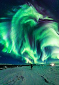 Green dragon-like aurora over Iceland.