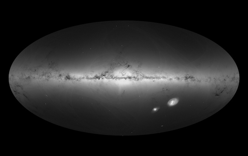 Oval with side view of Milky Way, two other galaxies below it.