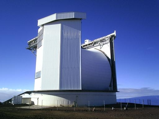 Giant telescope with huge horizantal cylinder between two buildings.