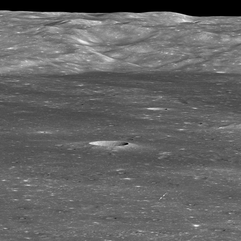 gray, cratered moon surface with two arrows pointing at a tiny dot.